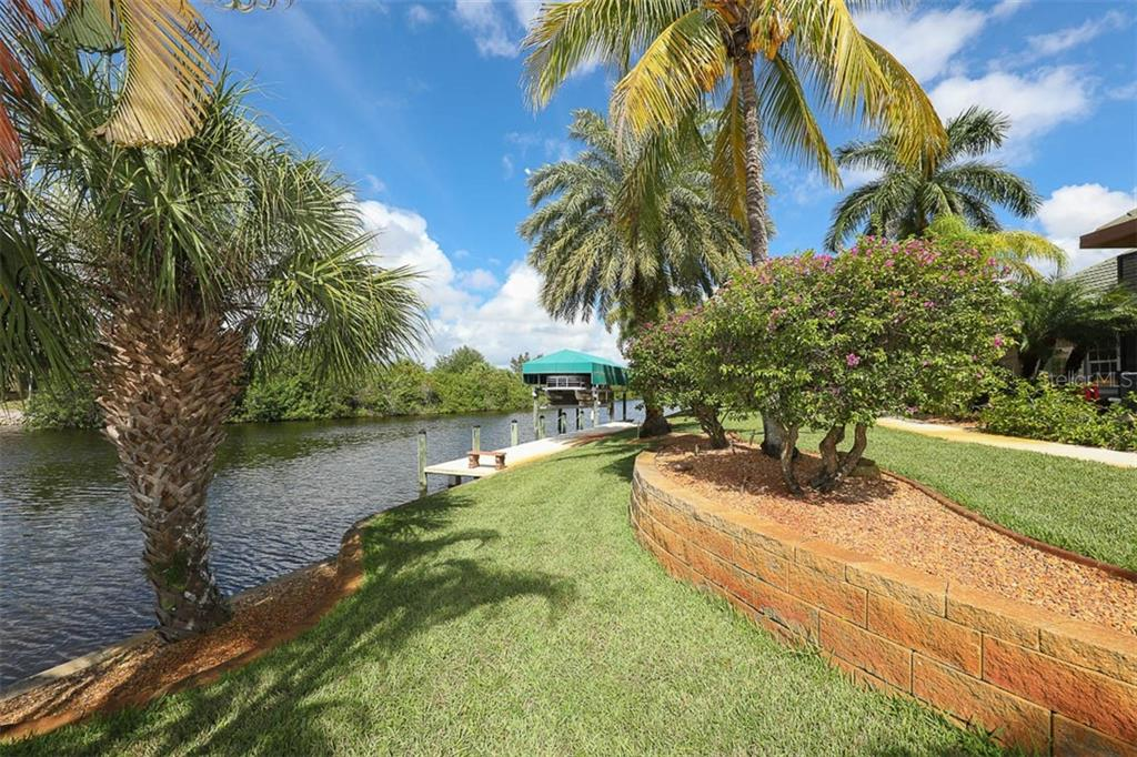 642 Feet of sea Wall, Tropical Landscape and Dock - Single Family Home for sale at 9300 Hialeah Ter, Port Charlotte, FL 33981 - MLS Number is D6113597