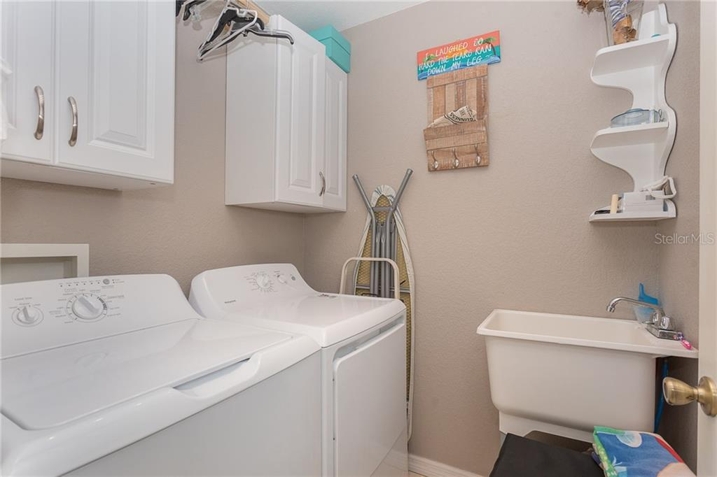 Interior laundry room offers extra storage with built-in cabinetry - Single Family Home for sale at 185 Apollo Dr, Rotonda West, FL 33947 - MLS Number is D6113690