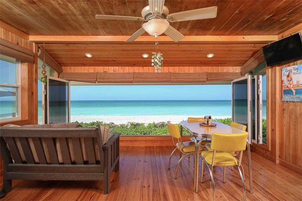 What a view from the Florida Room. The NanaWall of windows gets you as close to the beach as possible without getting sandy! - Single Family Home for sale at 4074 N Beach Rd #Ctg4, Englewood, FL 34223 - MLS Number is D6114111