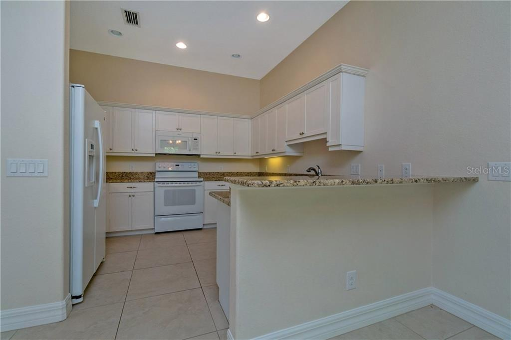 RECESSED LIGHTING IN THE FULLY EQUIPPED KITCHEN. - Single Family Home for sale at 112 Boxwood Ln, Rotonda West, FL 33947 - MLS Number is D6114179