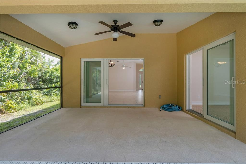 THE COVERED LANAI AREA CAN BE ACCESSED FROM THE GREAT ROOM AS WELL AS THE MASTER BEDROOM. - Single Family Home for sale at 112 Boxwood Ln, Rotonda West, FL 33947 - MLS Number is D6114179