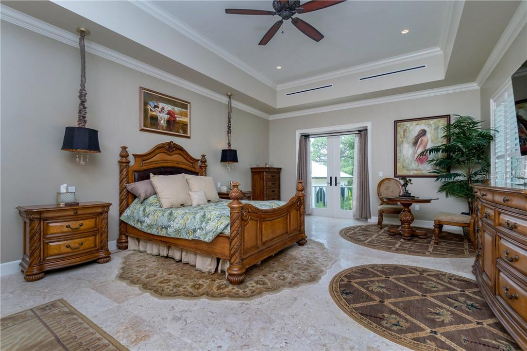 Plantation Shutters and high-efficiency cooling vents, Filipino Sand Shell tiles - Single Family Home for sale at 10161 Eagle Preserve Dr, Englewood, FL 34224 - MLS Number is D6114216