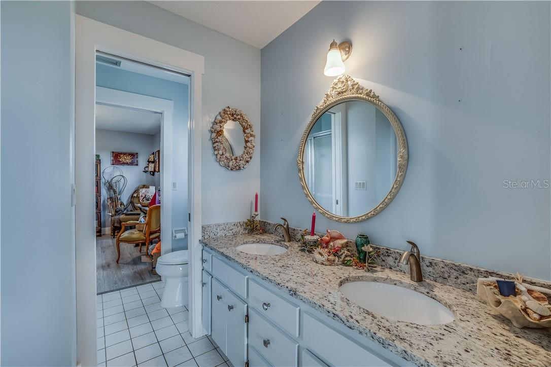 New countertops, sinks and toilets - Single Family Home for sale at 13000 Gasparilla Rd, Placida, FL 33946 - MLS Number is D6114315