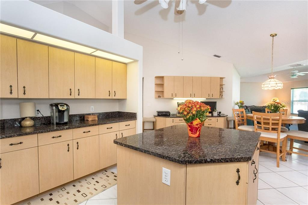 Plenty of work space in this large kitchen, with a built in desk area as well - Single Family Home for sale at 1720 Larson St, Englewood, FL 34223 - MLS Number is D6114414