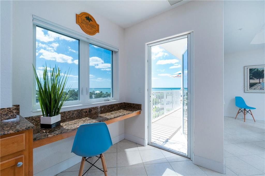 Your Desk and Balcony Off of the Kitchen - Condo for sale at 2225 N Beach Rd #401, Englewood, FL 34223 - MLS Number is D6114646
