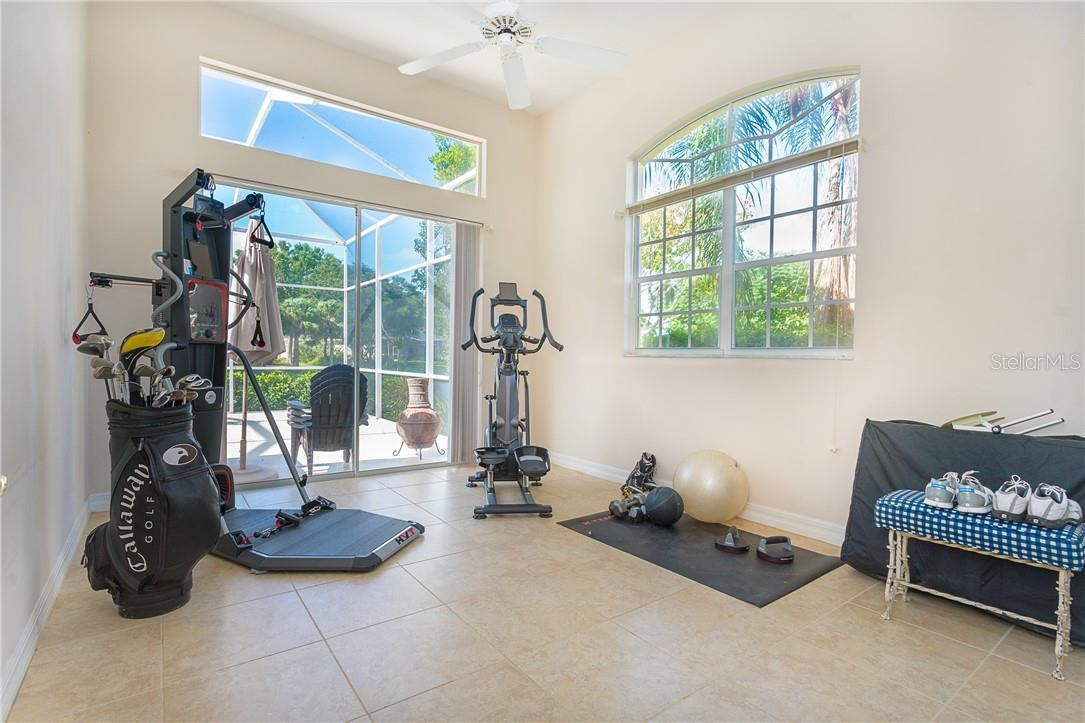 2nd Bedroom with sliding doors to the pool/lanai space - Single Family Home for sale at 18 Saint Croix Way, Englewood, FL 34223 - MLS Number is D6114880