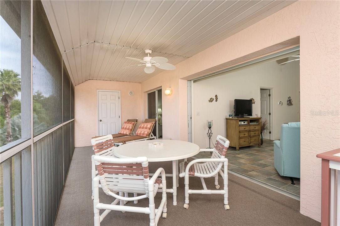 The pocketing sliding doors seamlessly blend your indoor space with your outdoors - Condo for sale at 6610 Gasparilla Pines Blvd #229, Englewood, FL 34224 - MLS Number is D6117434