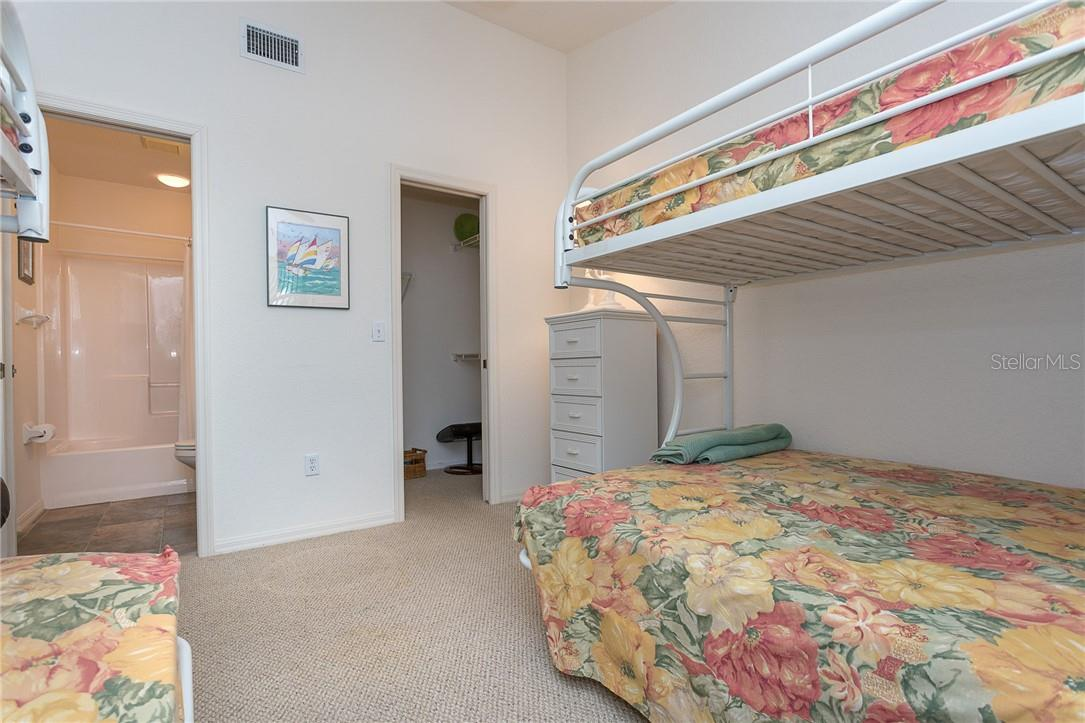 Bedroom 2 with walk-in closet - Condo for sale at 6610 Gasparilla Pines Blvd #229, Englewood, FL 34224 - MLS Number is D6117434