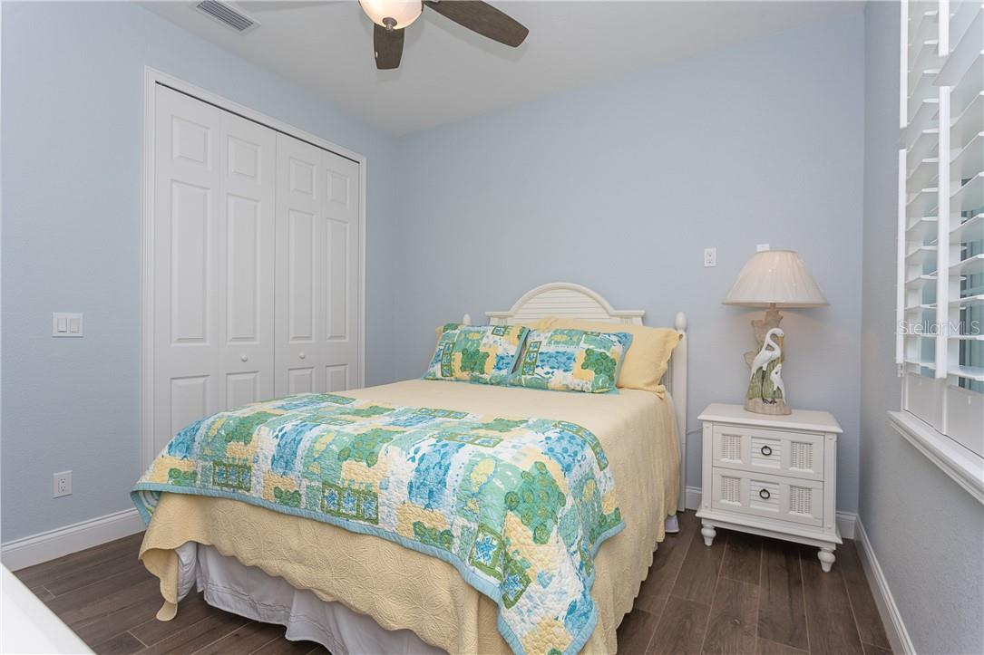 Bedroom 2 comes with a queen sized bed and plenty of room for your guests to feel at home - Single Family Home for sale at 145 Leland St Se, Port Charlotte, FL 33952 - MLS Number is D6117438