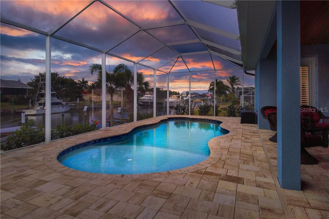 Enjoy great sunset views without leaving your lanai - Single Family Home for sale at 145 Leland St Se, Port Charlotte, FL 33952 - MLS Number is D6117438