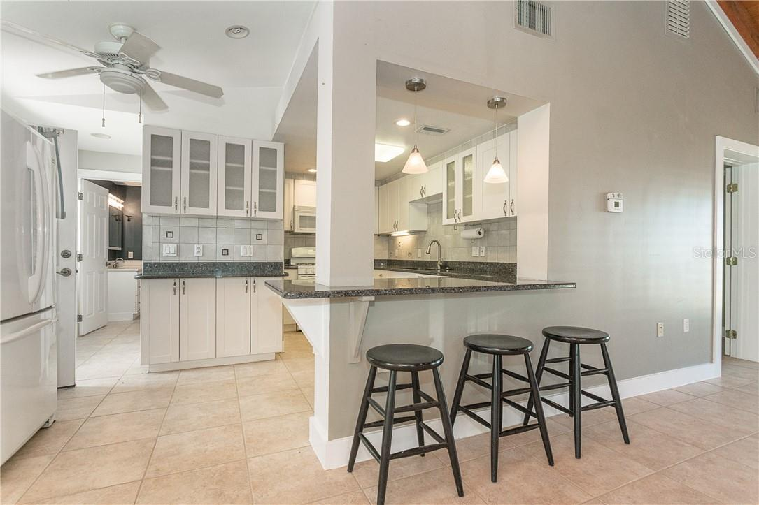 Open Kitchen to Dining & Great Room Area.  So many cabinets and so much storage. - Single Family Home for sale at 1661 New Point Comfort Rd, Englewood, FL 34223 - MLS Number is D6117712
