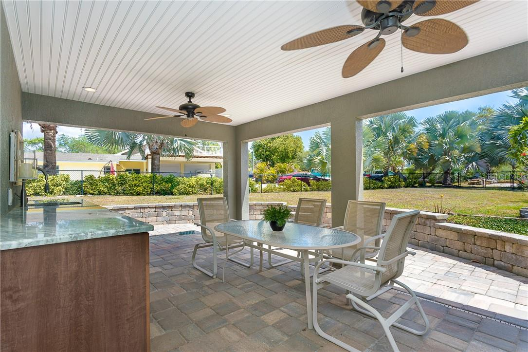 Great Outdoor dining space with a sink, extra counter space and storage for all your entertaining items - Single Family Home for sale at 1661 New Point Comfort Rd, Englewood, FL 34223 - MLS Number is D6117712