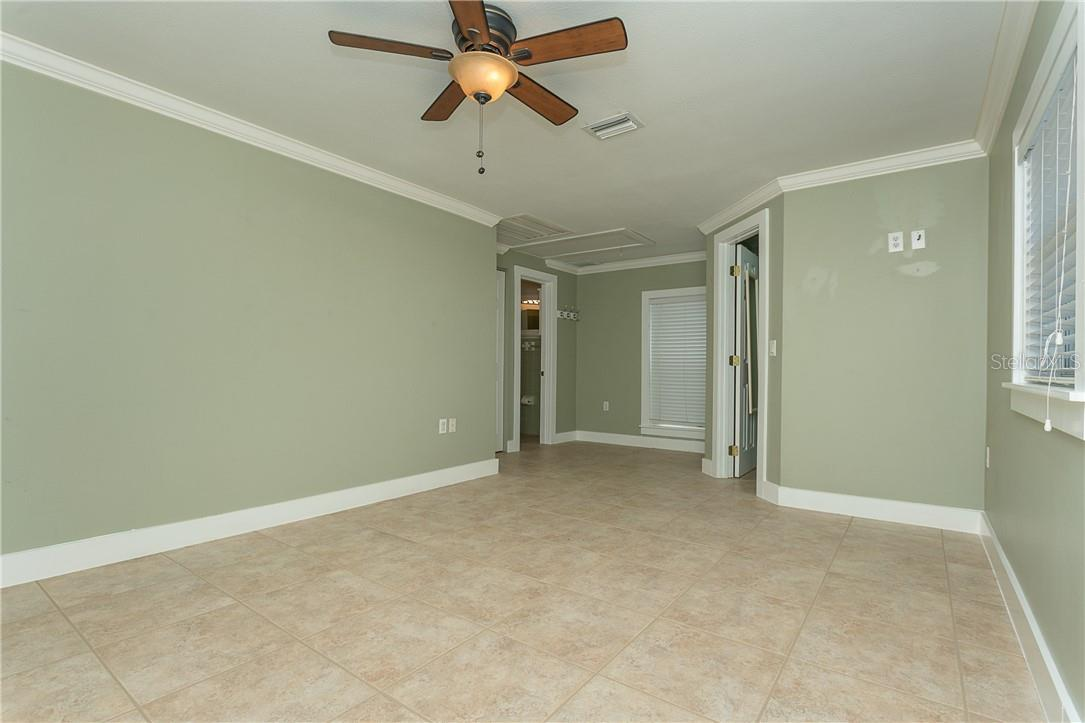 Crown Molding completes this spacious guest bedroom suite - Single Family Home for sale at 1661 New Point Comfort Rd, Englewood, FL 34223 - MLS Number is D6117712