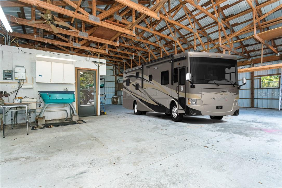 Can fit up to a 45' RV with 50 Amp Hookup.  This is a dream and what makes this property unique.  Keep everything out of the Florida sun. - Single Family Home for sale at 1661 New Point Comfort Rd, Englewood, FL 34223 - MLS Number is D6117712