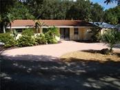 Front view - Single Family Home for sale at 3059 N Beach Rd, Englewood, FL 34223 - MLS Number is D5914248