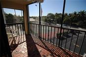 Private Lanai off Bedroom 3 with Tennis court views - Condo for sale at 970 Palm Ave #225, Boca Grande, FL 33921 - MLS Number is D5915744