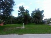 Front of lot from across the street - Vacant Land for sale at 32 Sportsman Way, Rotonda West, FL 33947 - MLS Number is D5918851