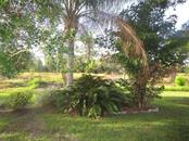 Backyard backs up to the preserve. - Condo for sale at 6796 Gasparilla Pines Blvd #14, Englewood, FL 34224 - MLS Number is D5919892