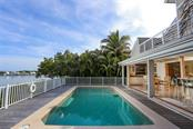 Sliders pocket into wall for totally unobstructed water views - Single Family Home for sale at 16740 Grande Quay Dr, Boca Grande, FL 33921 - MLS Number is D5920860