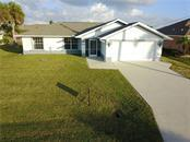 Single Family Home for sale at 9438 Rosebud Cir, Port Charlotte, FL 33981 - MLS Number is D5921057