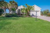 Single Family Home for sale at 209 Arlington Dr, Placida, FL 33946 - MLS Number is D6100071