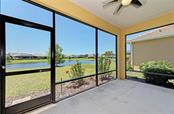 View of the lake from the screened lanai. - Single Family Home for sale at 141 Avens Dr, Nokomis, FL 34275 - MLS Number is D6100104