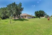Really nice piece of property in a non-deed restricted area of Englewood. - Single Family Home for sale at 7256 Holsum St, Englewood, FL 34224 - MLS Number is D6101787