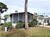 FUN IN FLORIDA in this 2BD/2BA/1CP Doublewide manufactured home in the popular Oak Grove. - Manufactured Home for sale at 1800 Englewood Rd #95, Englewood, FL 34223 - MLS Number is D6103776