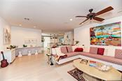This gathering room is well appointed and furnishings will remain with the exception of art on walls and personal items. - Single Family Home for sale at 7400 Manasota Key Rd, Englewood, FL 34223 - MLS Number is D6104362