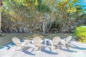 Relax in one of many seating arrangements around the vast property. - Single Family Home for sale at 7400 Manasota Key Rd, Englewood, FL 34223 - MLS Number is D6104362