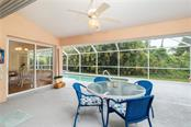 Imagine relaxing on this Lanai while sipping your favorite beverage. - Single Family Home for sale at 30 Medalist Way, Rotonda West, FL 33947 - MLS Number is D6106239