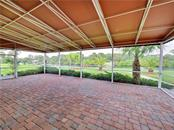 Screened lanai overlooking waterway with canopy over head - Single Family Home for sale at 13283 Eisenhower Dr, Port Charlotte, FL 33953 - MLS Number is D6107998