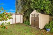 new shed providing extra storage - Single Family Home for sale at 913 Tropical Ave Nw, Port Charlotte, FL 33948 - MLS Number is D6108061