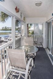 Another view of the balcony.  Accordian hurrican shutters protect the sliding glass doors. - Condo for sale at 7070 Placida Rd #1223, Placida, FL 33946 - MLS Number is D6108523