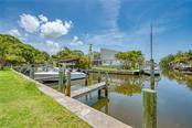 WOODEN DOCK FOR SALE WITH DIRECT ACCESS TO THE ICW, LEMON BAY AND THE GULF OF MEXICO. - Single Family Home for sale at 8171 Robert St #B106, Englewood, FL 34224 - MLS Number is D6113242