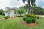 Lots of mature tropical landscaping. - Single Family Home for sale at 439 Boundary Blvd, Rotonda West, FL 33947 - MLS Number is D6114162