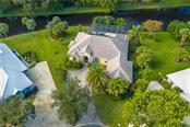 211' of Water frontage !!! - Single Family Home for sale at 18 Saint Croix Way, Englewood, FL 34223 - MLS Number is D6114880