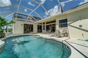 Feel the sun kiss your face and feel the warm tropical breeze, go ahead jump in the water is fine, but you may want to rinse off in the outdoor shower first. - Single Family Home for sale at 12307 S Access Rd, Port Charlotte, FL 33981 - MLS Number is D6117140