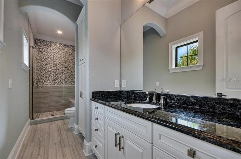 Second bedrooms ensuite bathroom - Single Family Home for sale at 1400 Harbor Sound Dr, Longboat Key, FL 34228 - MLS Number is T2932520