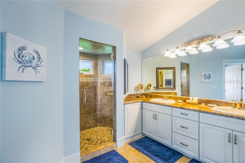 An ensuite bathroom for the second master bedroom includes a walk-in closet, double vanity, walk-in shower and private water closet. - Single Family Home for sale at 511 Loquat Dr, Anna Maria, FL 34216 - MLS Number is T3196169