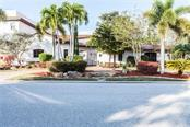 Single Family Home for sale at 1075 Bogey Ln, Longboat Key, FL 34228 - MLS Number is U7815562