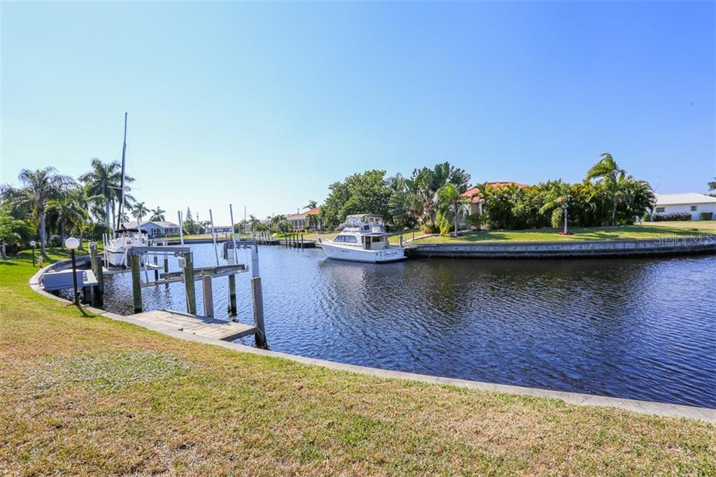 Dock/ 5K boat lift and view of intersecting canal - Single Family Home for sale at 3419 Sandpiper Dr, Punta Gorda, FL 33950 - MLS Number is C7232529