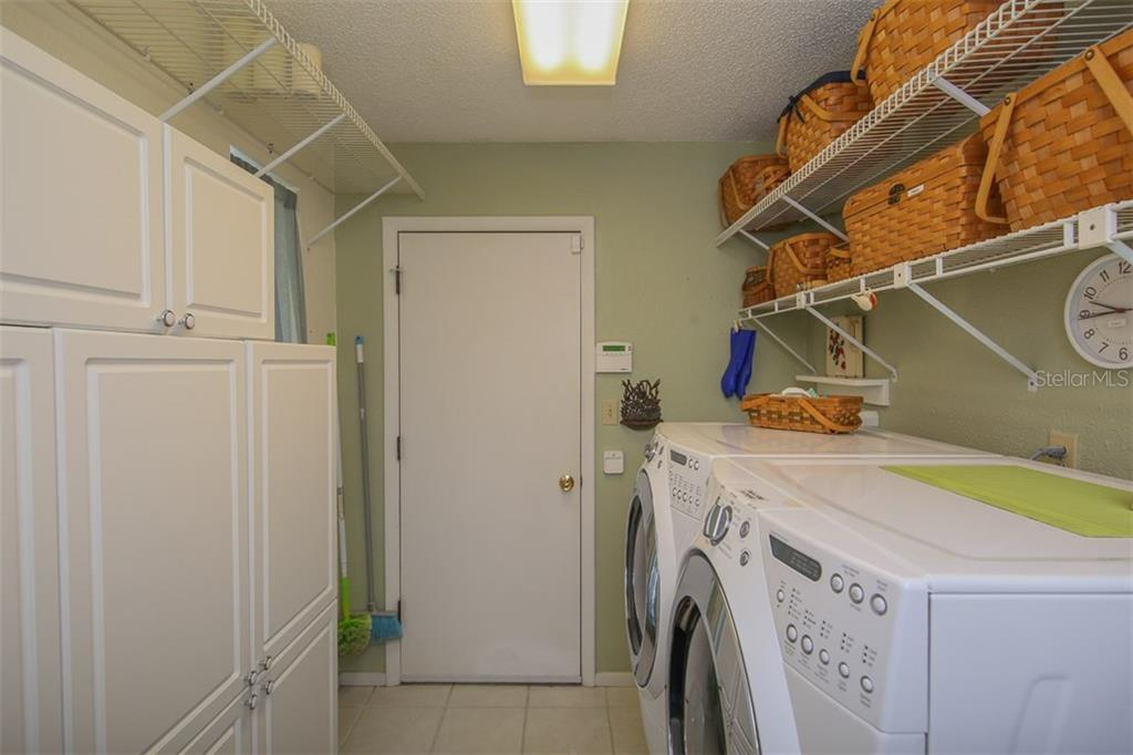 Inside Laundry with cabinetry off garage - Single Family Home for sale at 2332 Mauritania Rd, Punta Gorda, FL 33983 - MLS Number is C7234250