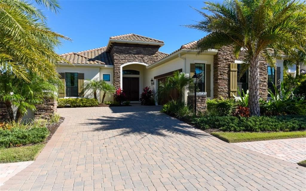 Single Family Home for sale at 7327 Haddington Cv, Lakewood Ranch, FL 34202 - MLS Number is C7235065