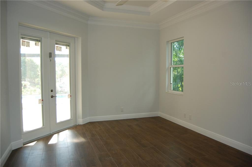 MASTER BEDROOM - Single Family Home for sale at 6030 Hollywood Blvd, Sarasota, FL 34231 - MLS Number is C7235083