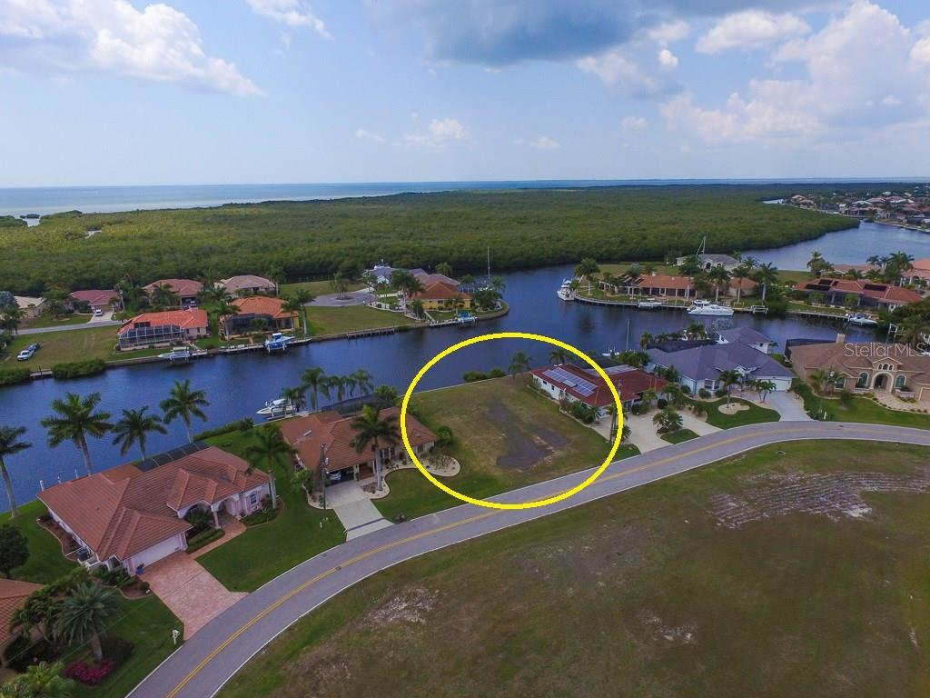 Concrete seawall is maintained by the City - Vacant Land for sale at 4027 Turtle Dove Cir, Punta Gorda, FL 33950 - MLS Number is C7237554