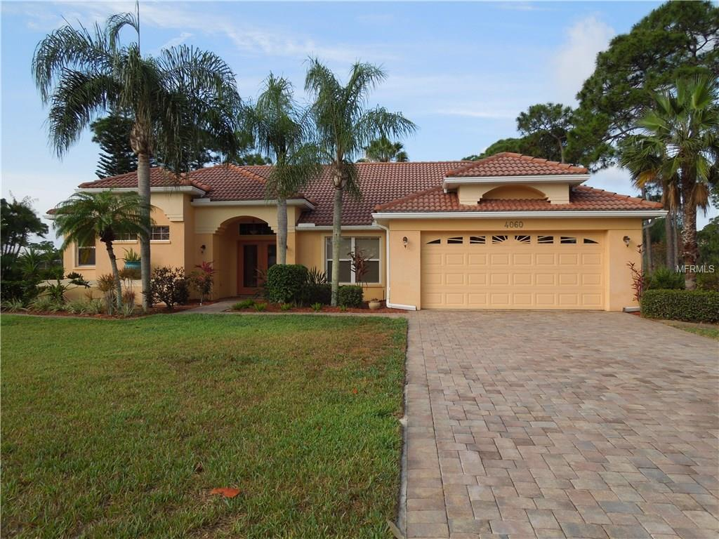FRONT VIEW FROM STREET NOTICE THE LONG PAVERED DRIVE NOT A NORM FOR THE MARINA. - Single Family Home for sale at 4060 Key Largo Ln, Punta Gorda, FL 33955 - MLS Number is C7239479