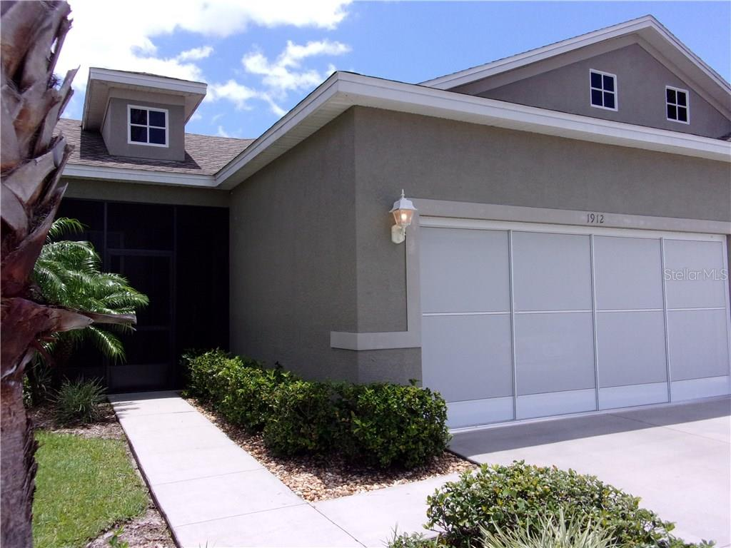 Welcome to 1912 Knights Bridge Trail!    Note: Screened Door on Garage - Villa for sale at 1912 Knights Bridge Trl, Port Charlotte, FL 33980 - MLS Number is C7239595