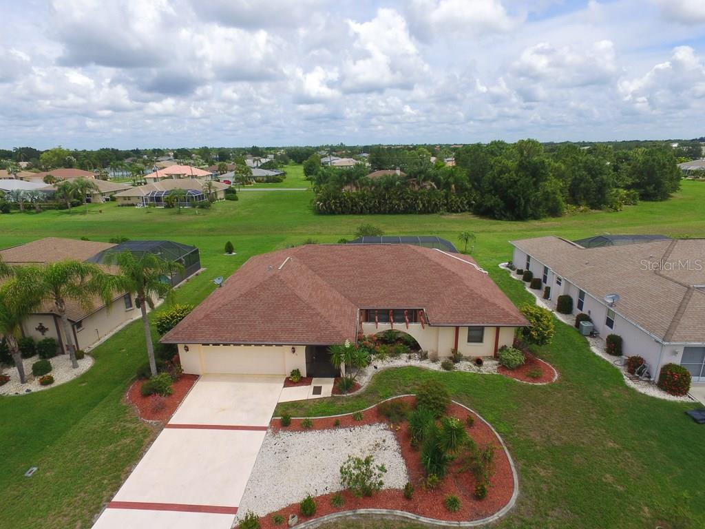 Beautiful home in deed-restricted Deep Creek with total privacy on the back - Single Family Home for sale at 26178 Rampart Blvd, Punta Gorda, FL 33983 - MLS Number is C7240559