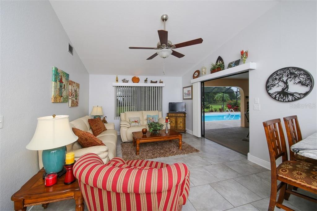 Family room with slider to the lanai and pool.  Breakfast bar in kitchen seats 2-3 comfortably - Single Family Home for sale at 26178 Rampart Blvd, Punta Gorda, FL 33983 - MLS Number is C7240559